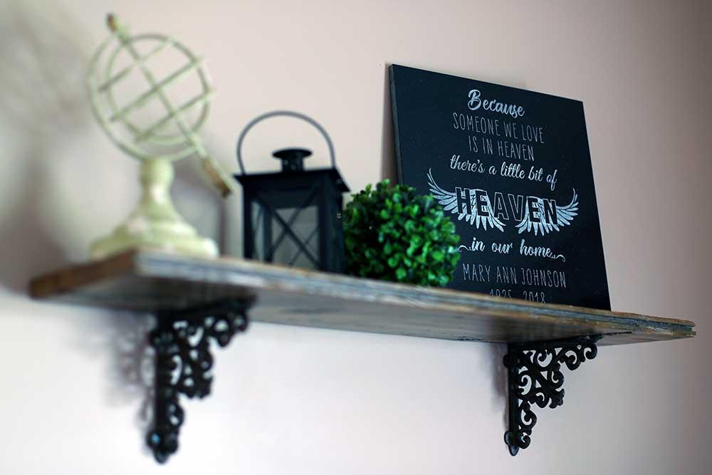 photo of memorial plaque on shelf